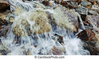 Water falls from the rock. Recorded at slow shutter speeds....