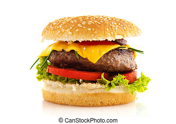 hamburger - Tasty cheeseburger with vegetables and bread...