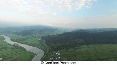 Small village on a hill near the river. Aerial view