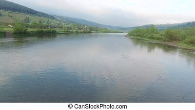 River in the valley a few hills and forests - Calm waters of...