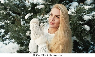 Russian beautiful woman in pine forest enjoying nature...