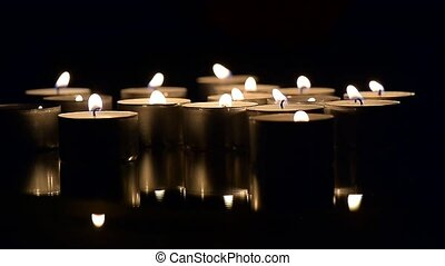 Lots of candles burning in the dark. At the end of the movie blow out