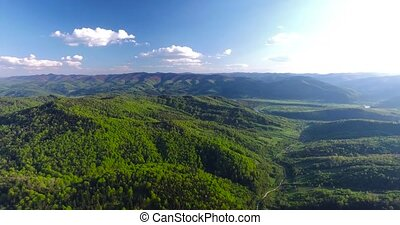 Panoramic shooting around hilly terrain. Aerial view -...