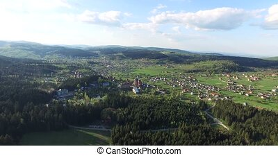View of the a small town in the valley, low houses close to...