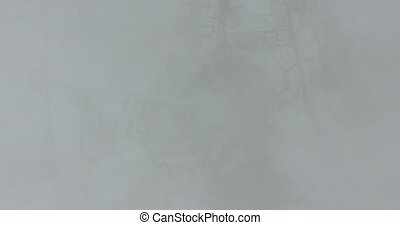 Because of the clouds seen a snowy town. Aerial view -...