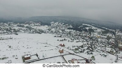 Small village beneath the hill in the valley. Aerial view -...