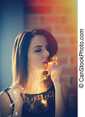 young woman with fairy lights - Portrait of a young woman...