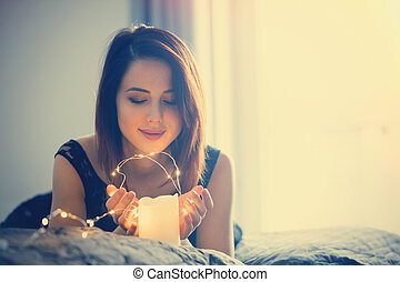 woman with fairy lights - Young woman with fairy lights...