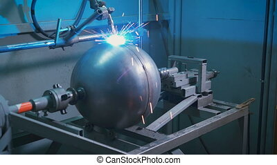 Electro welding working at the factory for the production of...