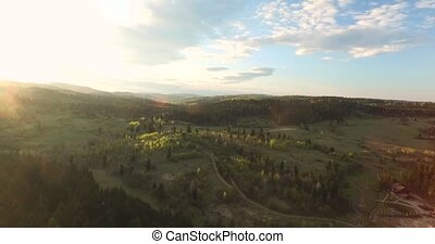 Aerial view. Sunny day over hilly terrain - Sunny day over...