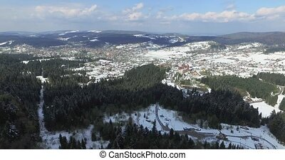 Aerial view. High over snowy village in the valley - High...