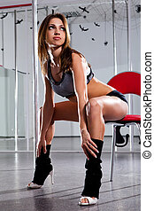Woman and pole-dance - Beautiful woman in a suit for the...