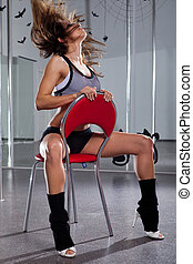 Woman and pole-dance - Pretty woman in a suit for the...