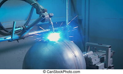 Arc welder at work on the production. From electric...