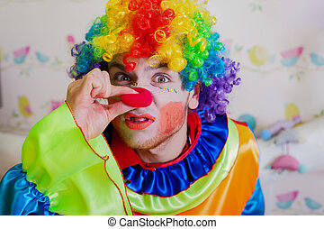 Clown pushes himself on the nose. - Funny clown with...