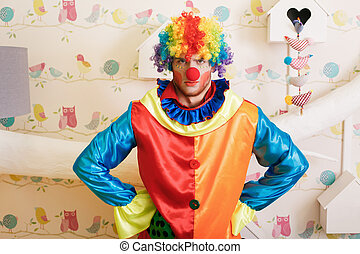 Serious clown in funny costume. - Serious clown in funny...