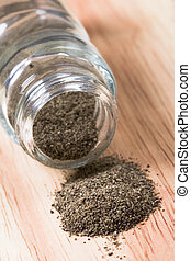 pepper shaker closeup on wooden background