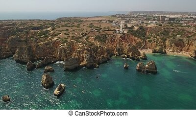 Aerial. Cape POnta de Piedade from the sky drone shot of beach time.