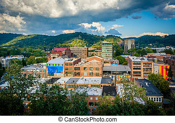 View of mountains and buildings in downtown Asheville, North...