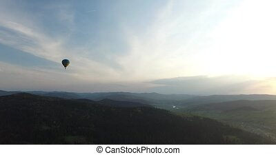 Balloon hovering above the forest. Aerial view - Balloon...