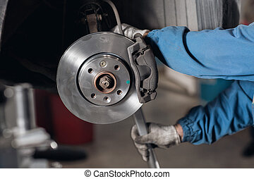 change the old drive to the Brand new brake disc on car in a...
