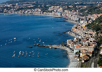 Giardini Naxos in Sicily, Italy, situated on the coast of...