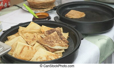 Frying pancakes with fillings on skillet. Close up - Frying...