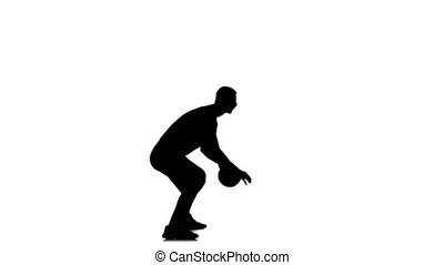Basketball player fills the ball with his hands. Side view. White background