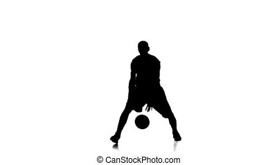 Basketball player jumping to continue to fill the ball....