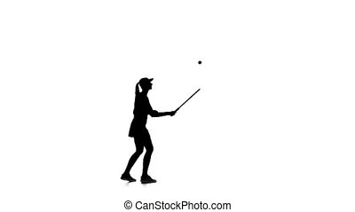 Tennis player throws the ball and hits a racket. White...