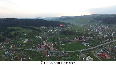 Inflatable balloon flies over a small town. Aerial view