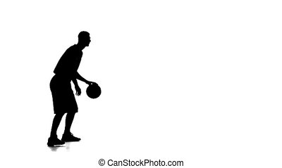 Basketball player fills the ball throws it forward. Side...