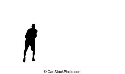 Basketball makes a feint, and stuffing the ball. Silhouette. White background
