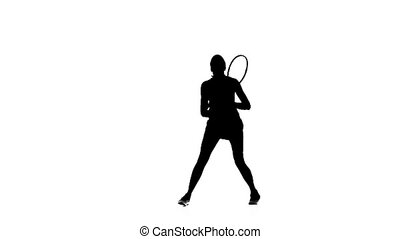 Tennis player playing racket and hits the ball. Silhouette....