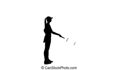 Tennis player throws the racket up and catches her. White...