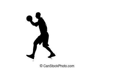 Basketball player holding the ball and makes a feint....