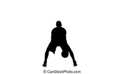 Basketball player fills the ball. Slow motion. Silhouette....