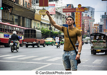 Man standing with hand up