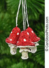 Mushrooms amanita, vintage decoration on a Christmas tree...