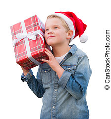 Young Boy Wearing Santa Hat Holding Christmas Gift