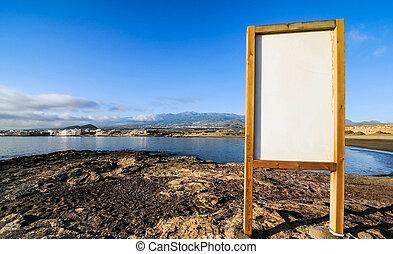 Cartel near the Atlantic ocean El Medano, Tenerife, Spain