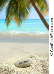 tropical peace stone - A peace stone in the white sand on a...