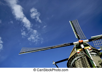 Windmill against a blue sky