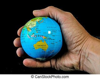 the world in your hand - Globe in an hand on a black...