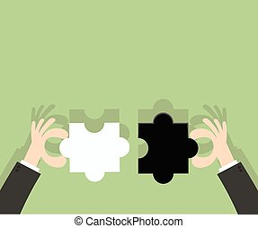 hands of businessman putting jigsaw puzzle pieces together
