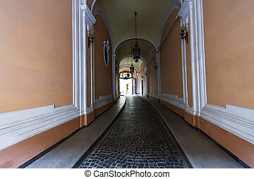 Old district of Lviv, Ukraine. - Long entrance to the...