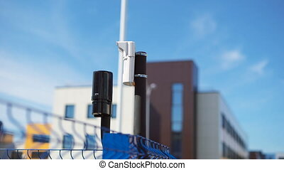 System of video surveillance and motion sensors are located...