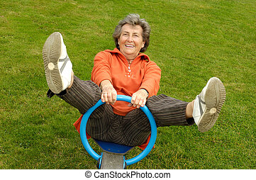 Senior woman on a playground - Active Senior woman on a...