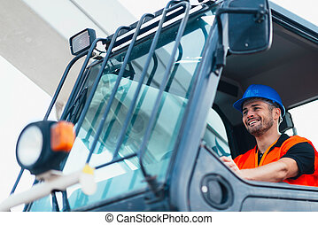 Construction worker operating on Skid Steer Loader