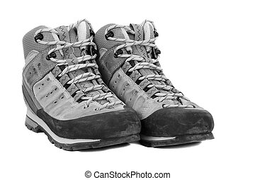 Old boots on white background, b/w tone